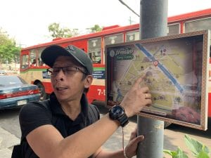 Thai man pointing at a map in Bangkok