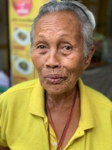 Elderly Thai woman in a yellow shirt